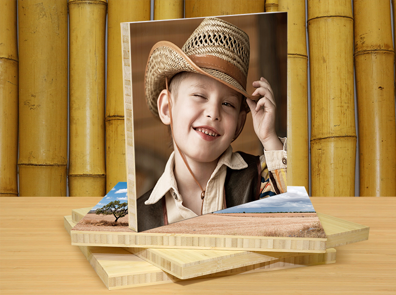 photo of boy wearing cowboy hat printed on bamboo
